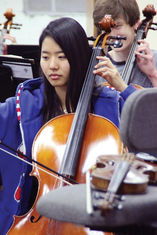 PLAYING HER CELLO - Senior Christina Cho rehearses in her Symphonic Orchestra class. Cho sits first chair.