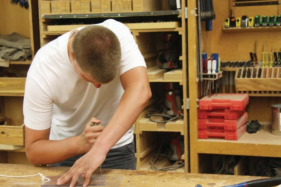 Working on a project, senior Adam Eudaly is taking Jay Hundley's cabinetry class. Students in career and technical education classes will have more opportunities when the new Career and Technical Education Center opens next year.