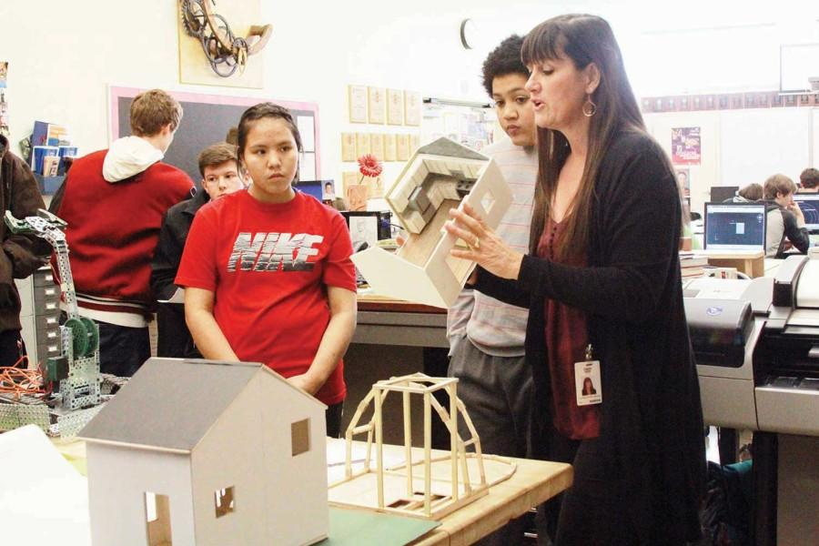 Explaining a class project, engineering teacher Charlie Lauts introduced her CTE classes to groups of incoming freshmen on Feb. 5.