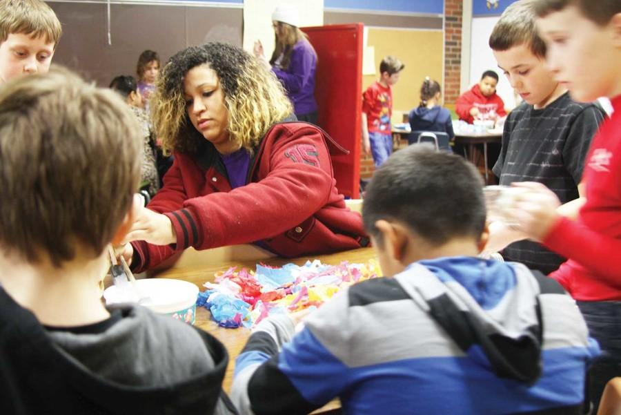 Assisting with an art project, senior Grace Barr volunteers with the Boys and Girls Club at Schwegler Elementary every day after school.