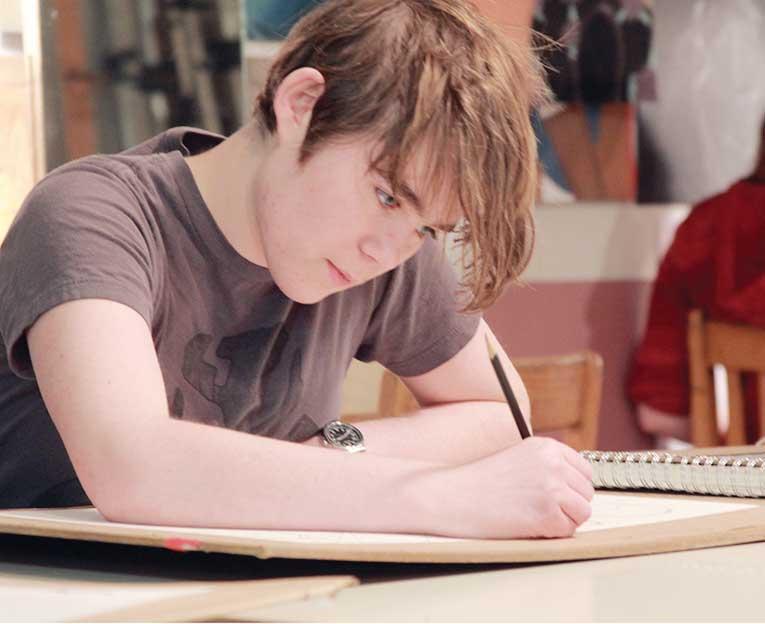 Beginning a project, junior Riley Costlow works in Wendy Vertacnik's AP Studio Art class seventh hour.
