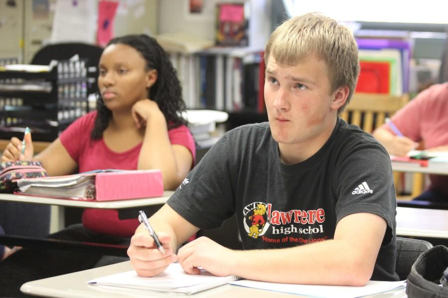 Listening to a lecture, junior Josh Bash attended AP US History teacher Valarie Schrag's first AP review session on March 30.