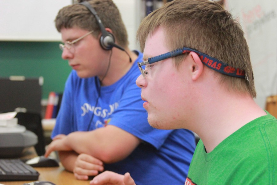 """Seniors Adam Graham and Matthew Walter work in the journalism room. They conducted interviews and helped with other tasks this year. """"My favorite thing is helping out, trying to get some interviews and having fun with other classmates,"""" Walter said."""
