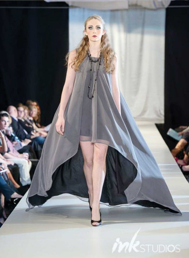Taking center stage, senior Makayla Wagner models at the Kansas City Fashion Week 2014 last September. Photo provided by Makayla Wagner