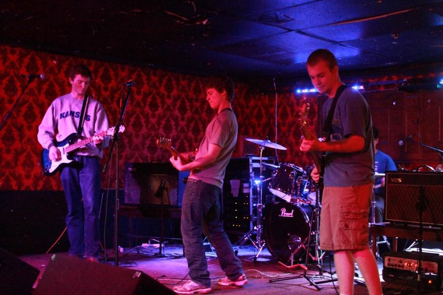 Seniors Trevor Hall, Keegan Matheis, and Izaak Workman play a show at the Jackpot on Feb. 14.