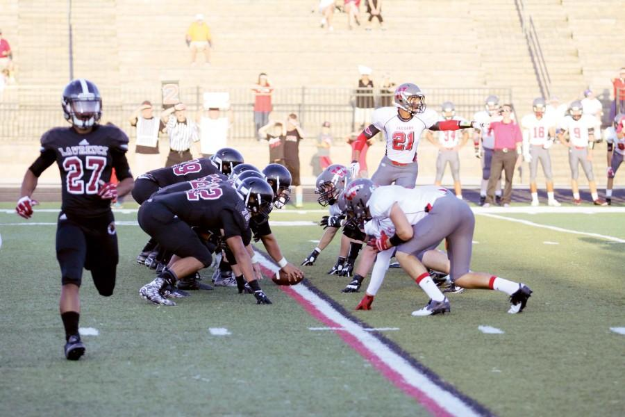 Players line up for the first home football game Sept. 4. Recent changes in regulations have limited the amount of contact time in practices and have forbidden the scheduling of two consecutive games.