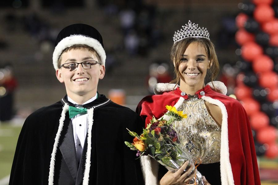 Senior Kennedi Wright-Conklin accepts her crown during halftime accompanied by senior Colton Lovelace.