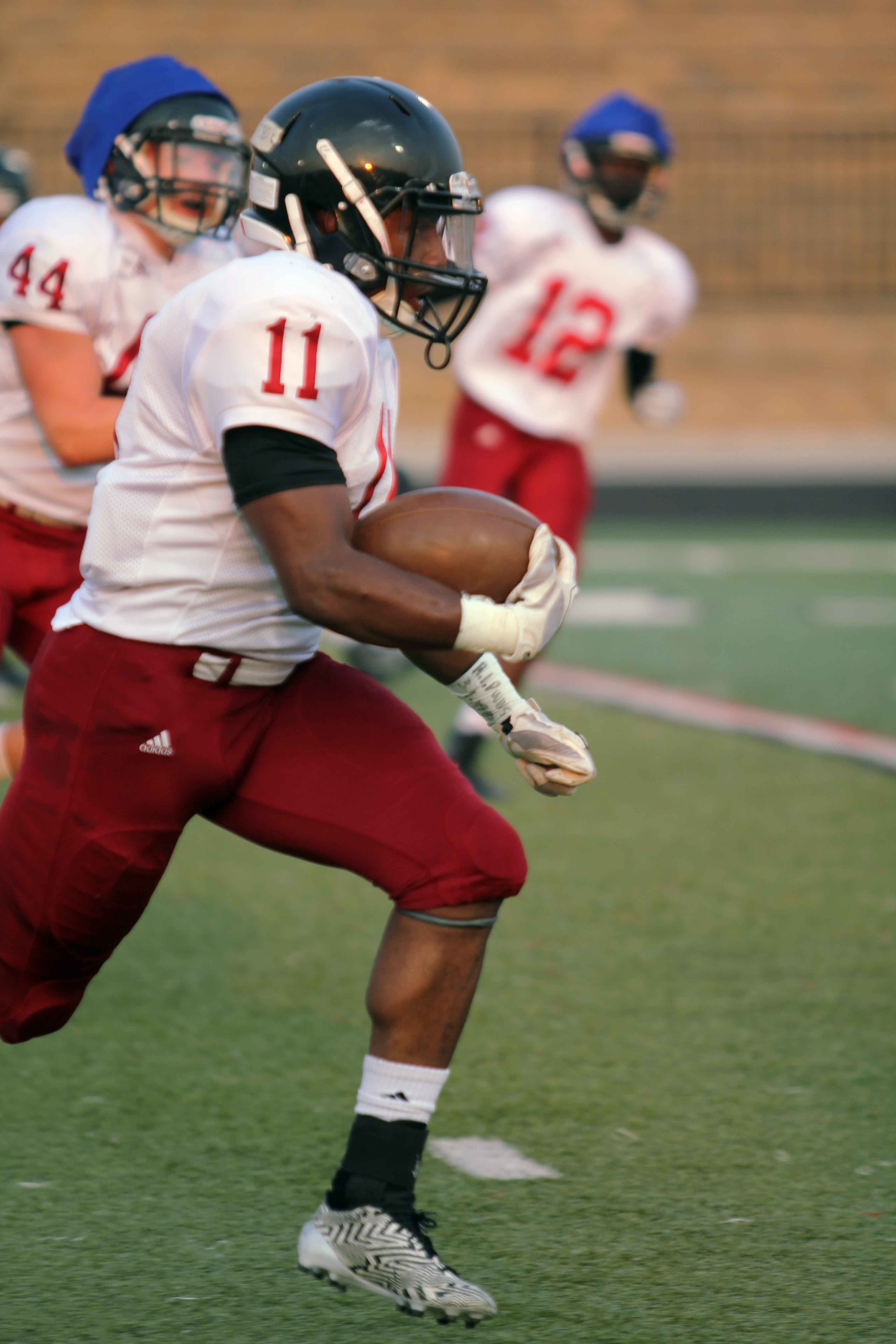 Senior JD Woods runs the ball at the Jamboree. Woods recently broke the school record for career rushing yards in a game at Olathe Northwest.