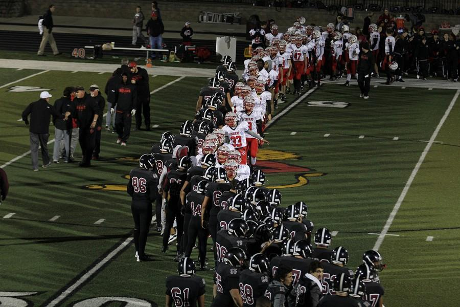 Lions shake hands with Shawnee Mission North football players after the home victory Nov. 6 at LHS.