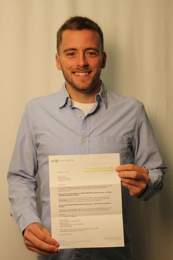 LHS alumnus Bobby Davis poses with the letter that informed him he was matched as a bone marrow donor.