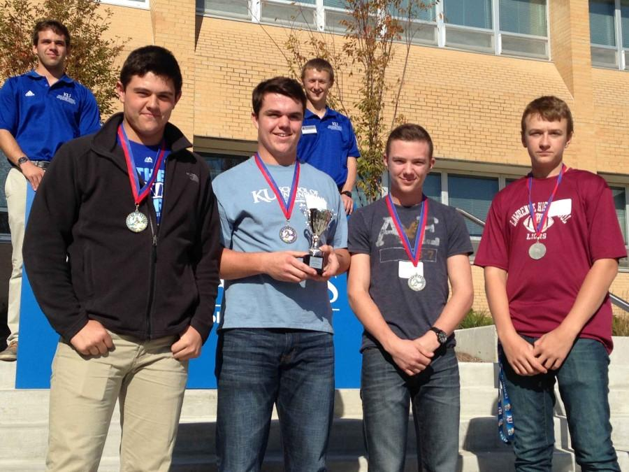 Sophomores Devin Lauts, Ethan Taylor, Ryan Hafenstine and Ian Henricks pose victoriously with their medals after their second place win at the University of Kansas engineering competition. Photo courtesy of Charlie Lauts