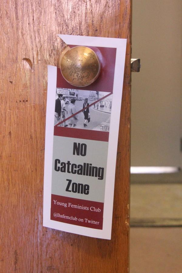 The Young Feminist Club is taking a stand against catcalling by putting door hangers around the school and other efforts.