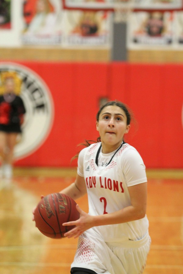 Junior Olivia Lemus goes up for a free throw on Dec. 14, 2015 against Topeka West. The Lions won tonight against Topeka High 56-44.