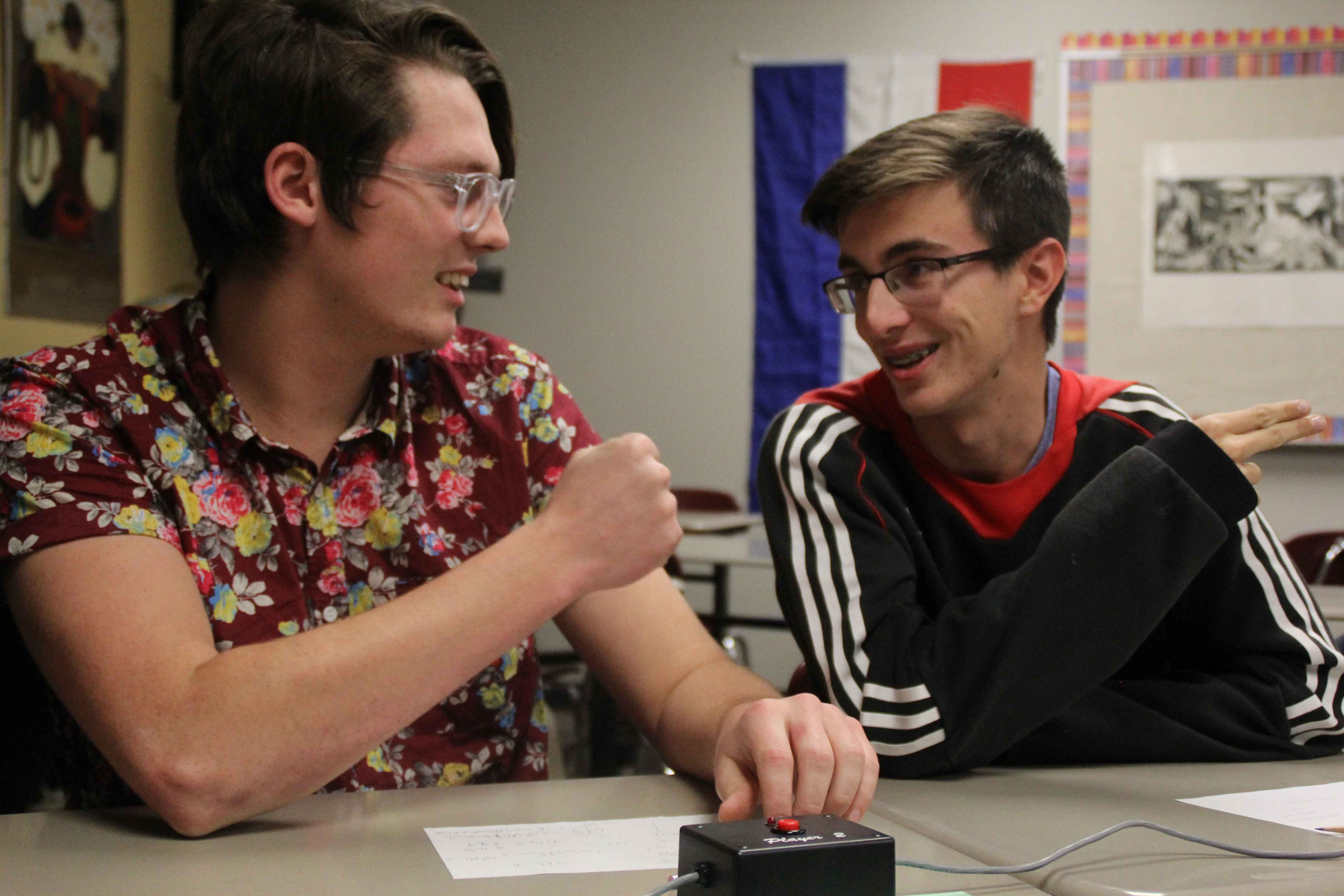 """Seniors Ethan Doores and Kai Blosser participate in a Scholars Bowl practice round on Dec. 3. """"I started going to Scholar's Bowl last year, but I didn't get to any meets because of cross country. But this year I went to a lot of meets,"""" Blosser said. The club hosted 18 teams at their annual tournament on Jan. 27."""