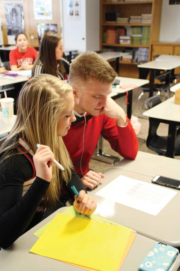 Juniors Sydney Haralson and Jackson Mallory work in the LINK Leadership class.