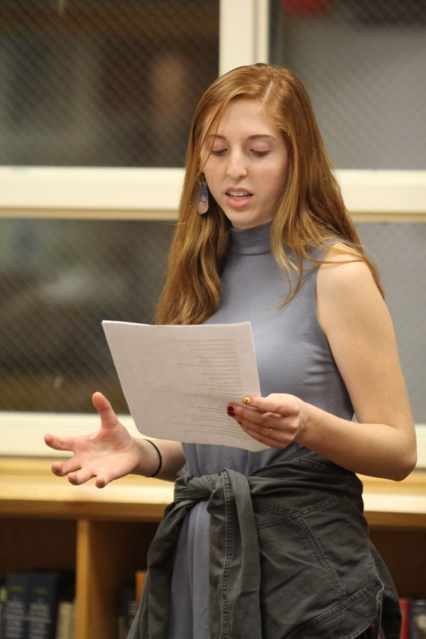 Sophomore Claire Walther reads a poem at Poetry Club on Feb. 4.