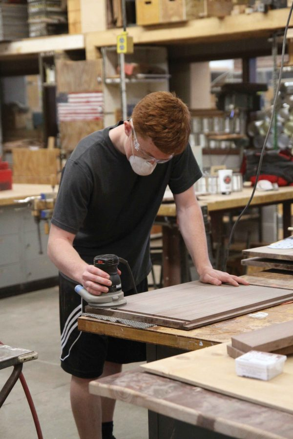 Senior Chase Odgers works on creating a box in the woodshop fifth hour. Odgers spends much of his day working on engineering and woodshop classes.