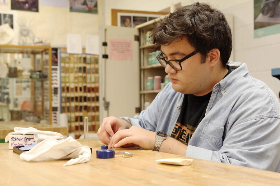 "Senior David Balmilero works on a project in Deena Amont's class. He said he enjoys the medium of jewelry. ""I think it's something that you touch and feel, so it's a very intimate item you can make,"" he said. ""That's pretty rad."""