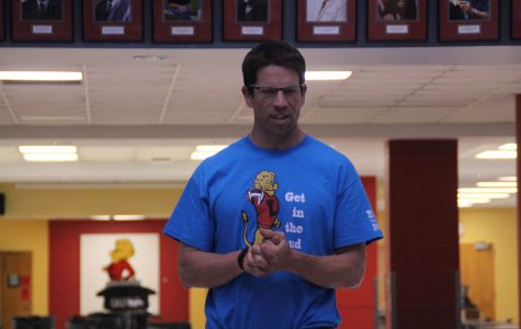 Latin teacher Jason Lichte works with students on a reenactment in the rotunda last week.