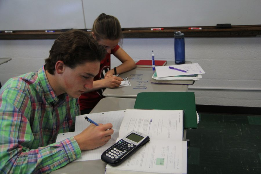 Sophomore Jackson Hoy works on an assignment in Pamela Fangohr's fifth hour math class.