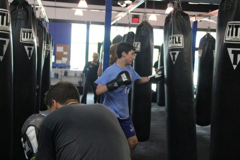 Freshman Noah Ginsberg attends a boxing class at Uppercut Fitness on Saturday, April 30.