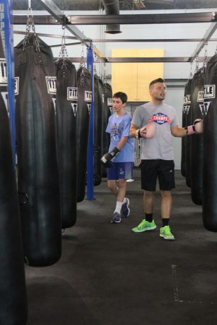 Security guard Michael Anderson instructs boxing students at Uppercut Fitness on Saturday, April 30.
