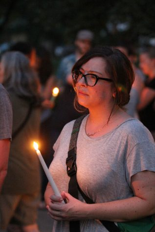 Sympathizing — English and theater teacher Jamie Johnson shows support at the candlelit. Photo by Ian Jones