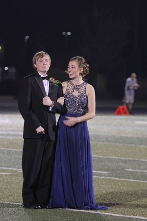 Stand-in Jake Barker and Homecoming Queen Hannah Reed wait on the field to be crowned at the football game on Friday, Sept. 23