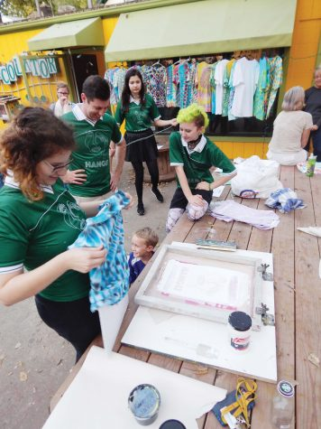 creating — Seniors Allie Fischer and Toby Weston screenprint T-shirts at the Percolator as part of their show.