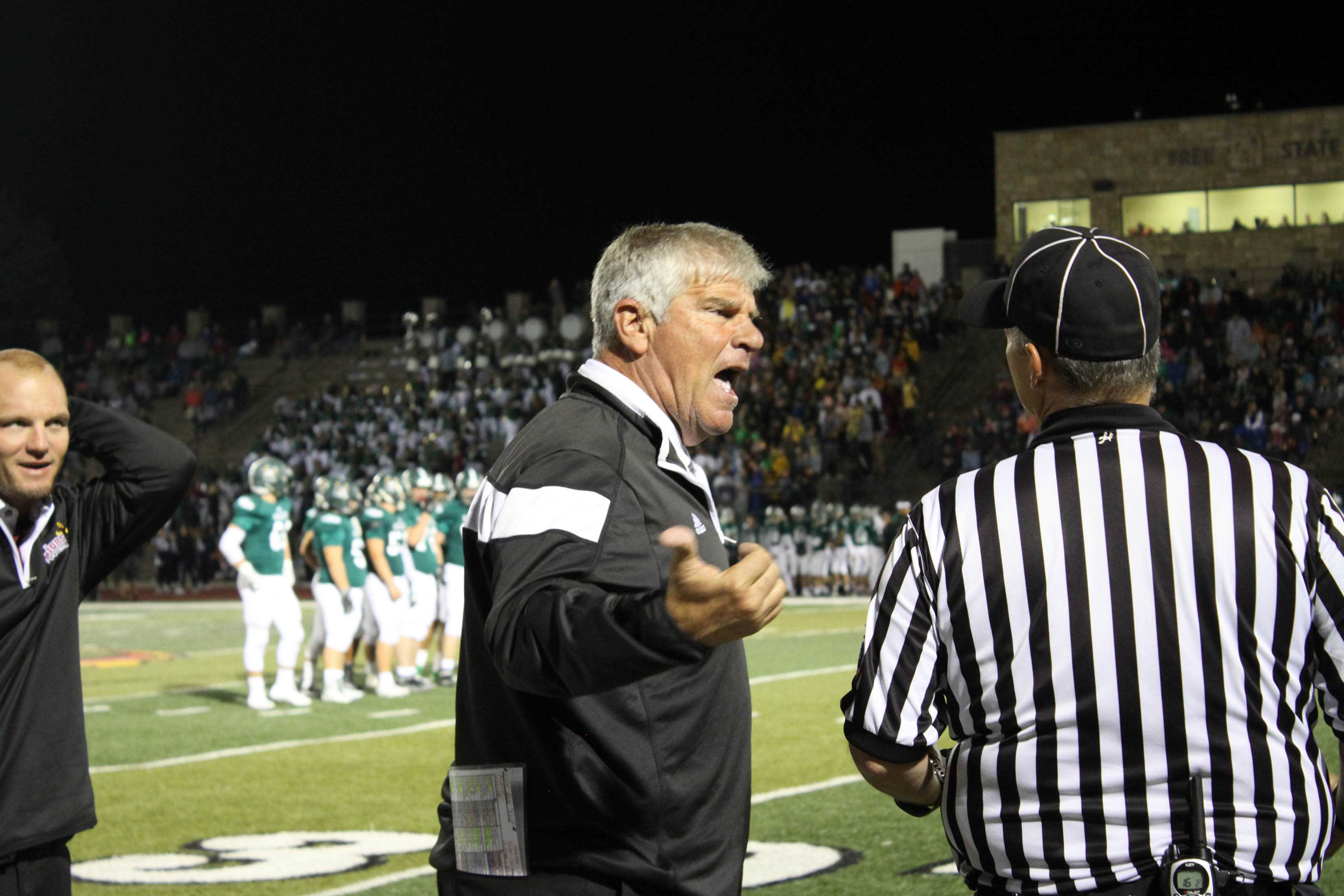 Head football coach Dirk Wedd talks on the sidelines at the City Showdown. Lions lost to Free State 42-7.