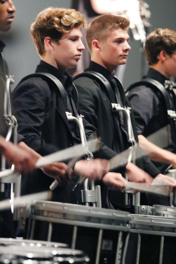 "FAMILY — Bryce Dunn and Brendan Blanco stand with drumline, during the last performance of ""Fortune Teller"" at Gala. ""Having the power and volume of performing in the auditorium is much different than performing on the field,"" Dunn said."