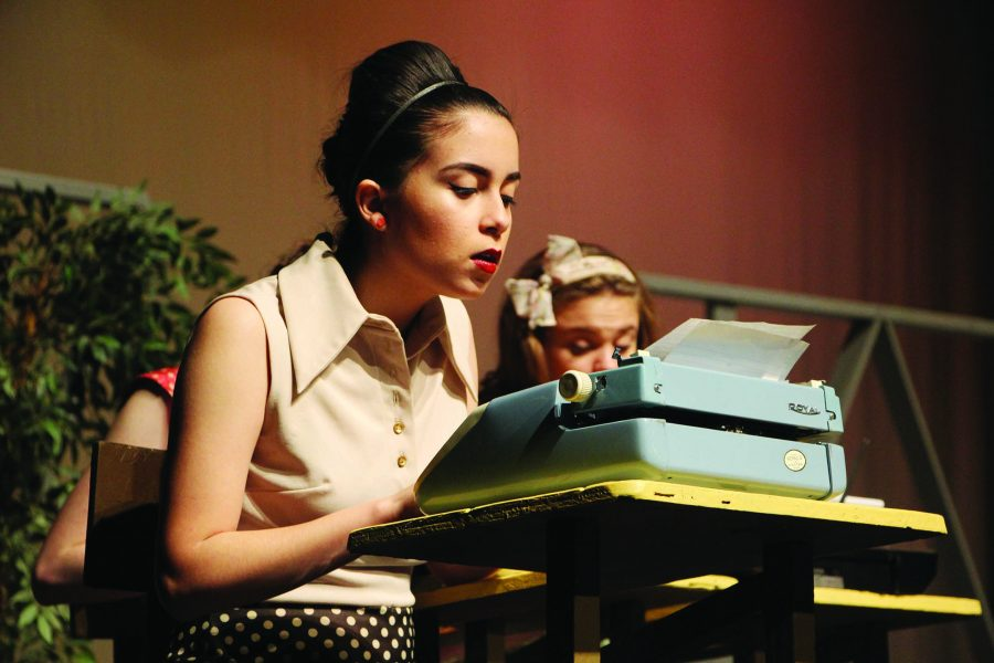 Typing — Junior Grayson Rodriquez focuses on her role as the secretary in the play.