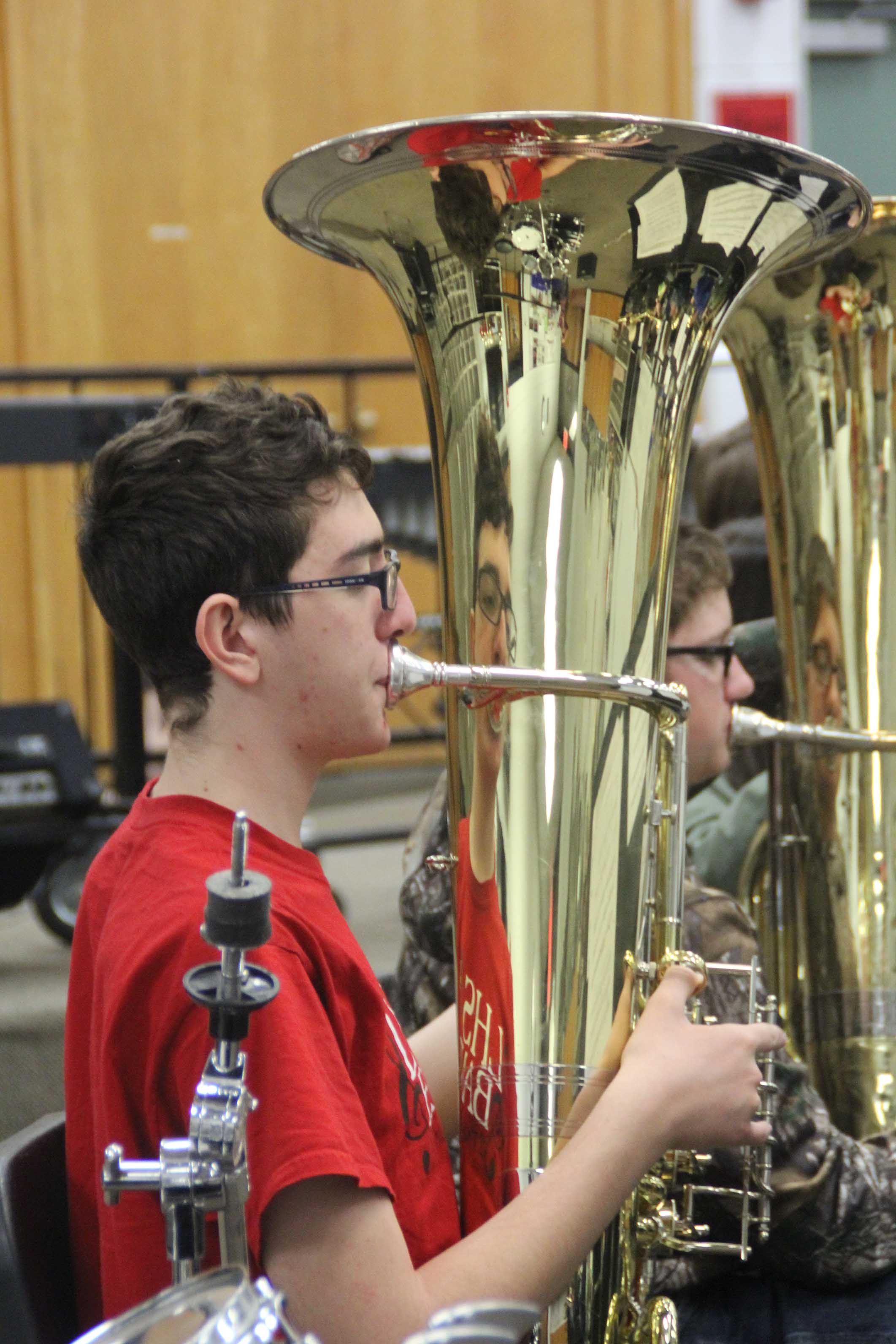Practicing — Concert tuba player, Noah Stussie, plays in preparation for the Regional Music Competition.