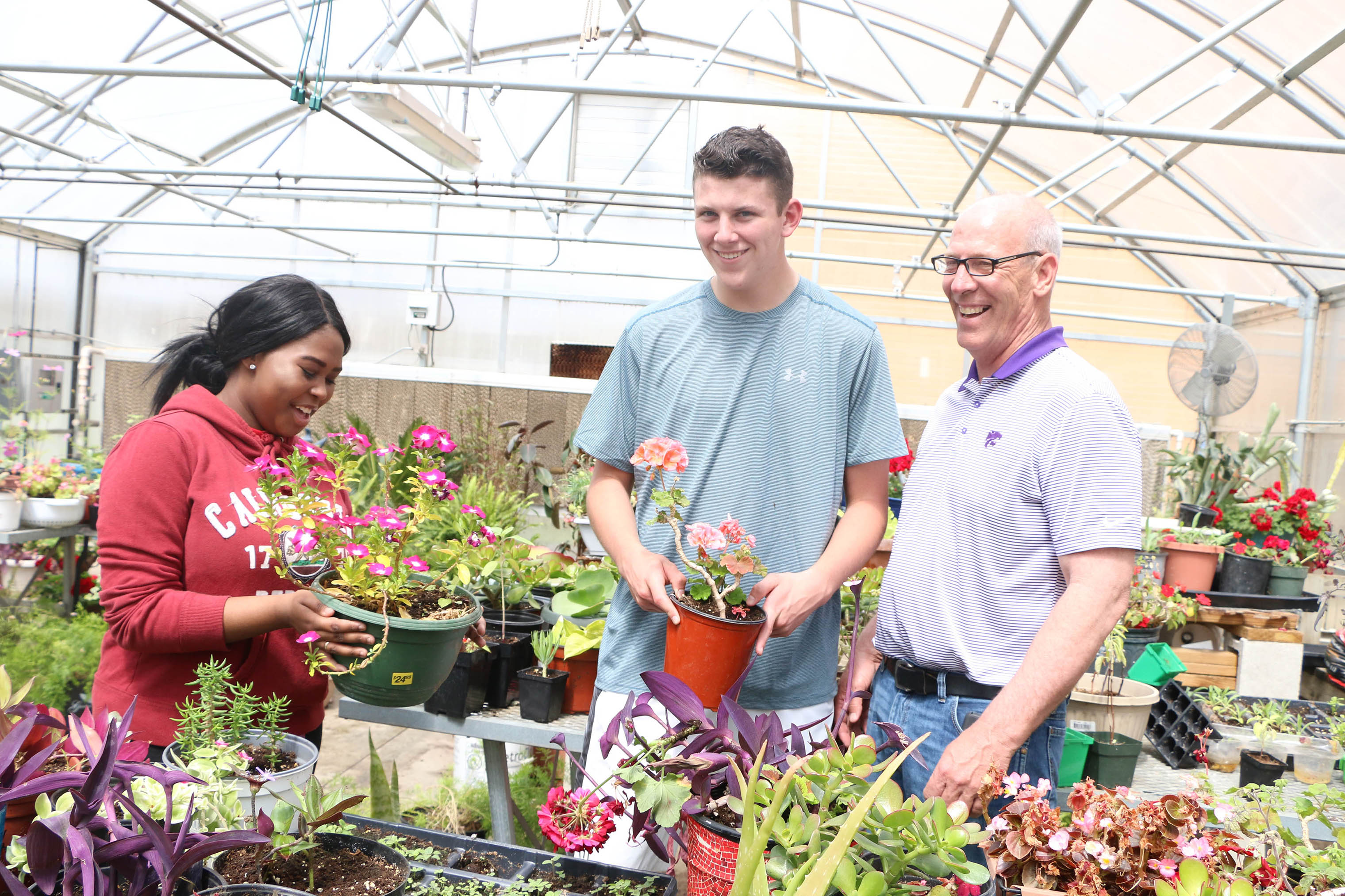 Animal and Plant Science teacher Mark Rickabaugh teaches students in the greenhouse. He is retiring this year.