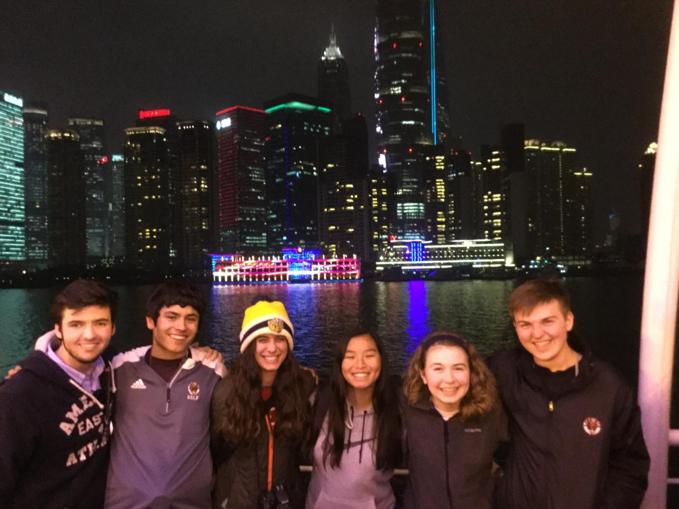 Smiling wide — Students pose in front of the Bund waterfront in Shanghai. Platt took his group to many other iconic Chinese landmarks.