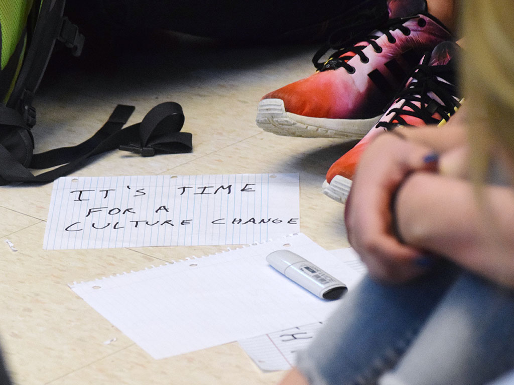 Students created hand-written sings to hold during the sit-in on Monday at Lawrence High School