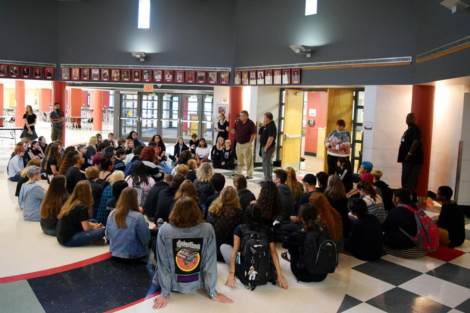 Students begin gathering for a sit-in during second hour on Monday in the rotunda. The crowd grew as the day went on.