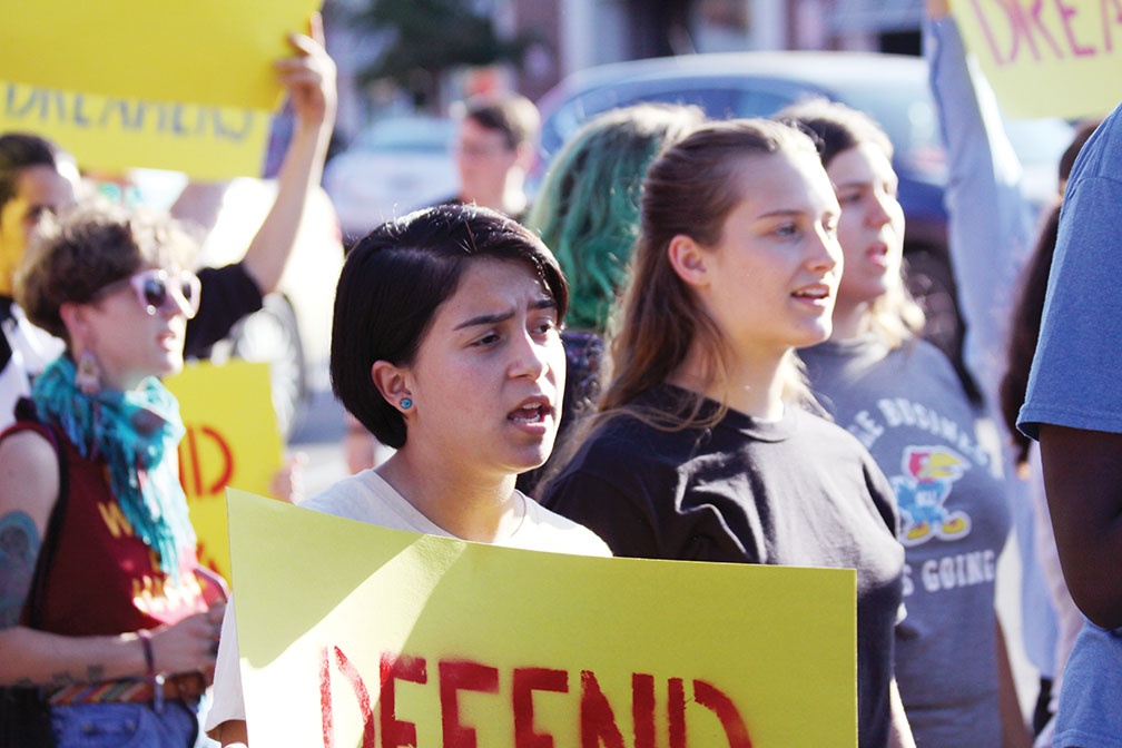 Protest — Marching down Massachusetts Street, seniors Grayson Rodriquez and Tia Herrman join a demonstration on Sept. 7 to speak out against President Donald Trump's decision to end the Deferred Action for Childhood Arrival program.