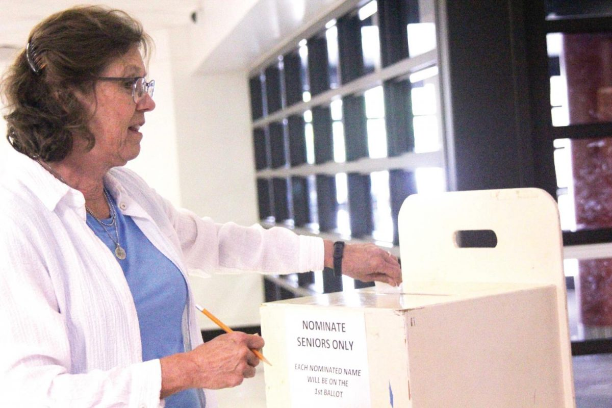 At the Ballot — Casting a ballot, art teacher Wendy Vertacnik participates the nomination process for Homecoming Court. Among the changes this year, teachers could make nominations.