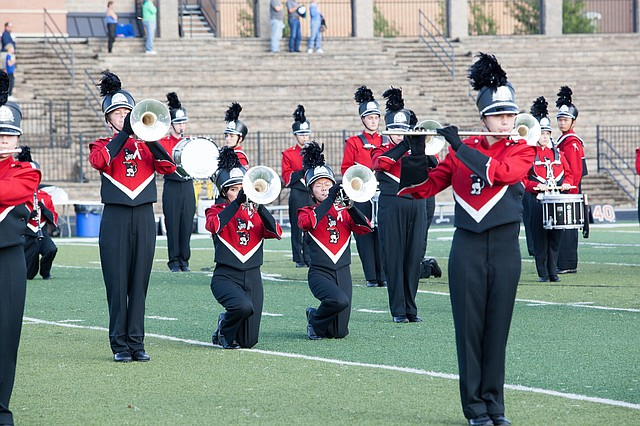 Protest — Two members of the Lawrence High School marching band kneel during the national anthem before a football game Friday, Oct. 6, 2017. Photo courtesy of the Lawrence Journal World.
