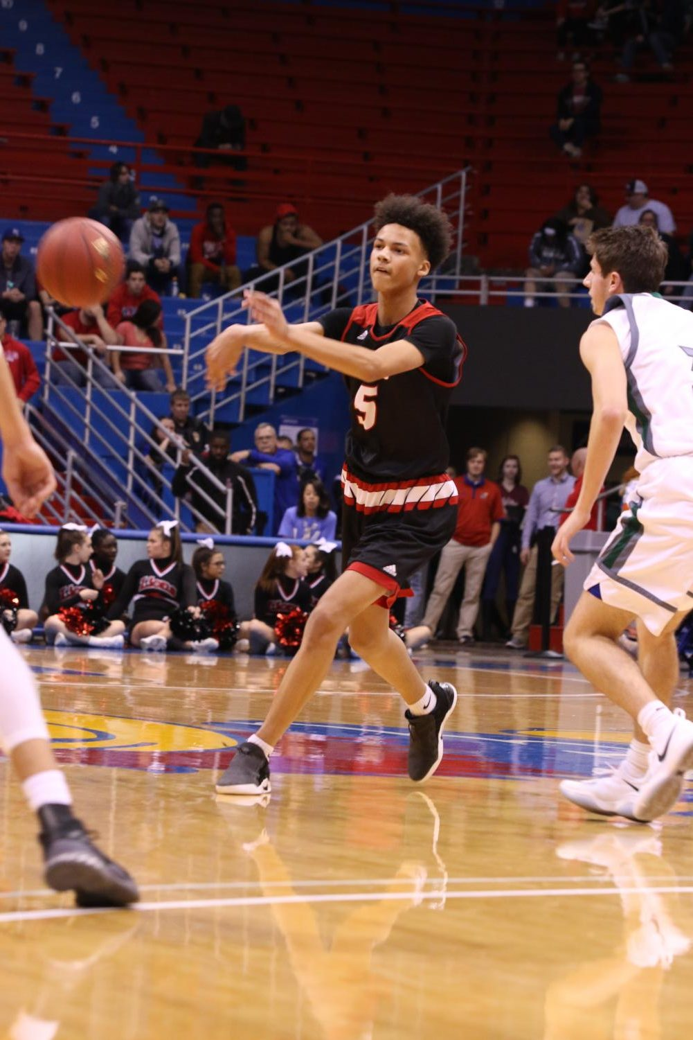 Freshman Zeke Mayo sprays it out to a teammate on Friday night vs. Free State at Allen Fieldhouse. Mayo would finish with 7 points.