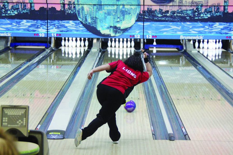 triking a pose — Senior Diamonique Vann bowls at Royal Crest Lanes at the Lawrence Quad tournament. She finished with a 695 series.