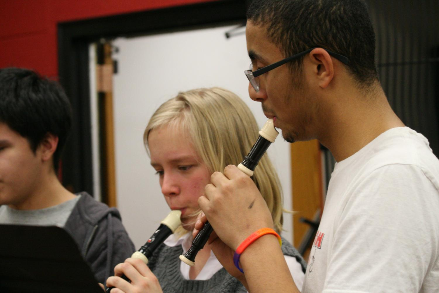 "blown Away — Harmonizing, senior Mark Garcia and sophomore Rose Hicks play their recorders as they participate in the ensemble Going for Baroque. The ensemble practiced and played the tune 'Lux Aeterna.' ""I thought it would be fun and ironic to play an instrument that most people find annoying,"" Hicks said. ""I enjoyed the people in it because they were OK with the fact that I haven't played since fifth grade, and they let me take time to relearn and remember how to play the recorder."""