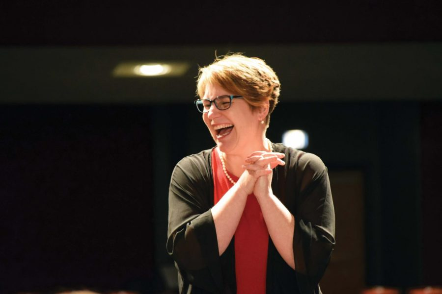 JOYFUL+%E2%80%94+Rachel+Dirks+enjoys+conducting+the+orchestras+at+the+February+concert.+She+will+begin+her+new+position+as+director+of+orchestras+at+Kansas+State+University+this+fall.+