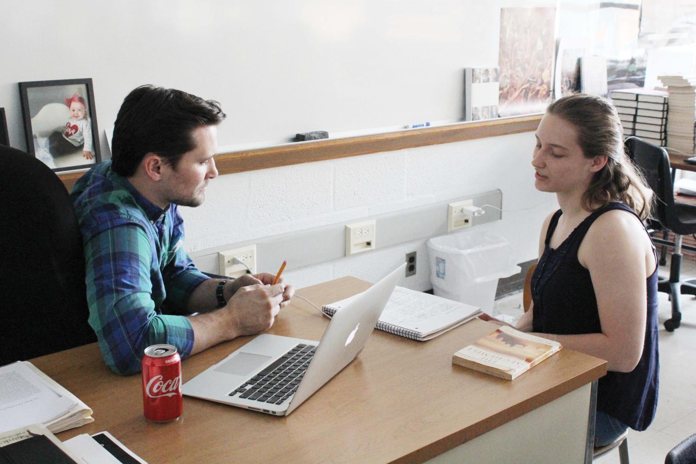 Teaching — English teacher Matt Stiles helps senior Tia Herrman with an assignment during his sixth-hour AP Literature class.