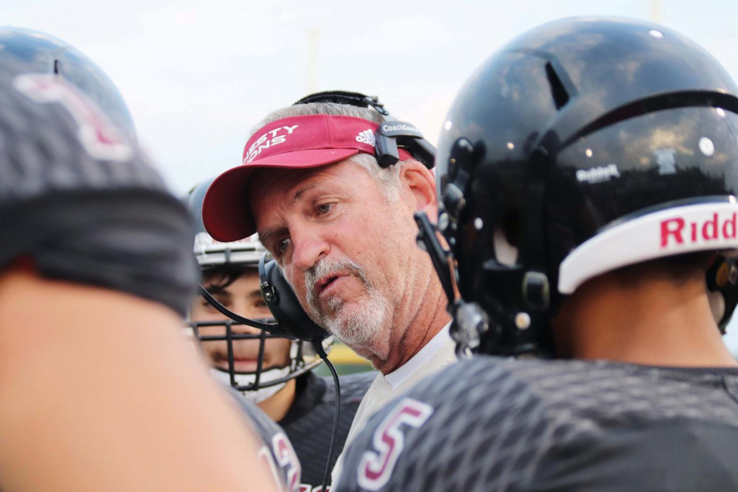 New head football coach, Steve Rampy, calls a play from the sideline during the annual fall sports Jamboree. Rampy, who is entering his 40th season of coaching, was hired this past spring following the retirement of former coach Dirk Wedd.