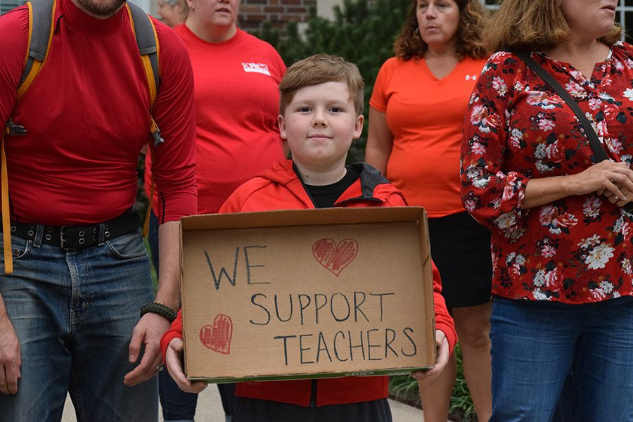 Members of the community gathered in support of teachers outside Liberty Memorial Central Middle School on Sept. 6.