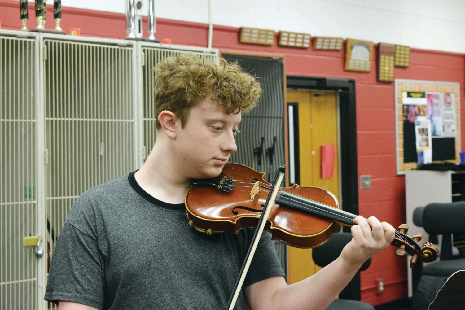 "Fiddling around, senior Jack Foster has taken on the responsibility of hosting Fiddle Club after school in the orchestra room. Foster plans to expand on activities the club does. ""Orchestra class is a lot more structured"" Foster said. ""Fiddle Club is a lot more of improvisation and a lot more casual and simple music."""