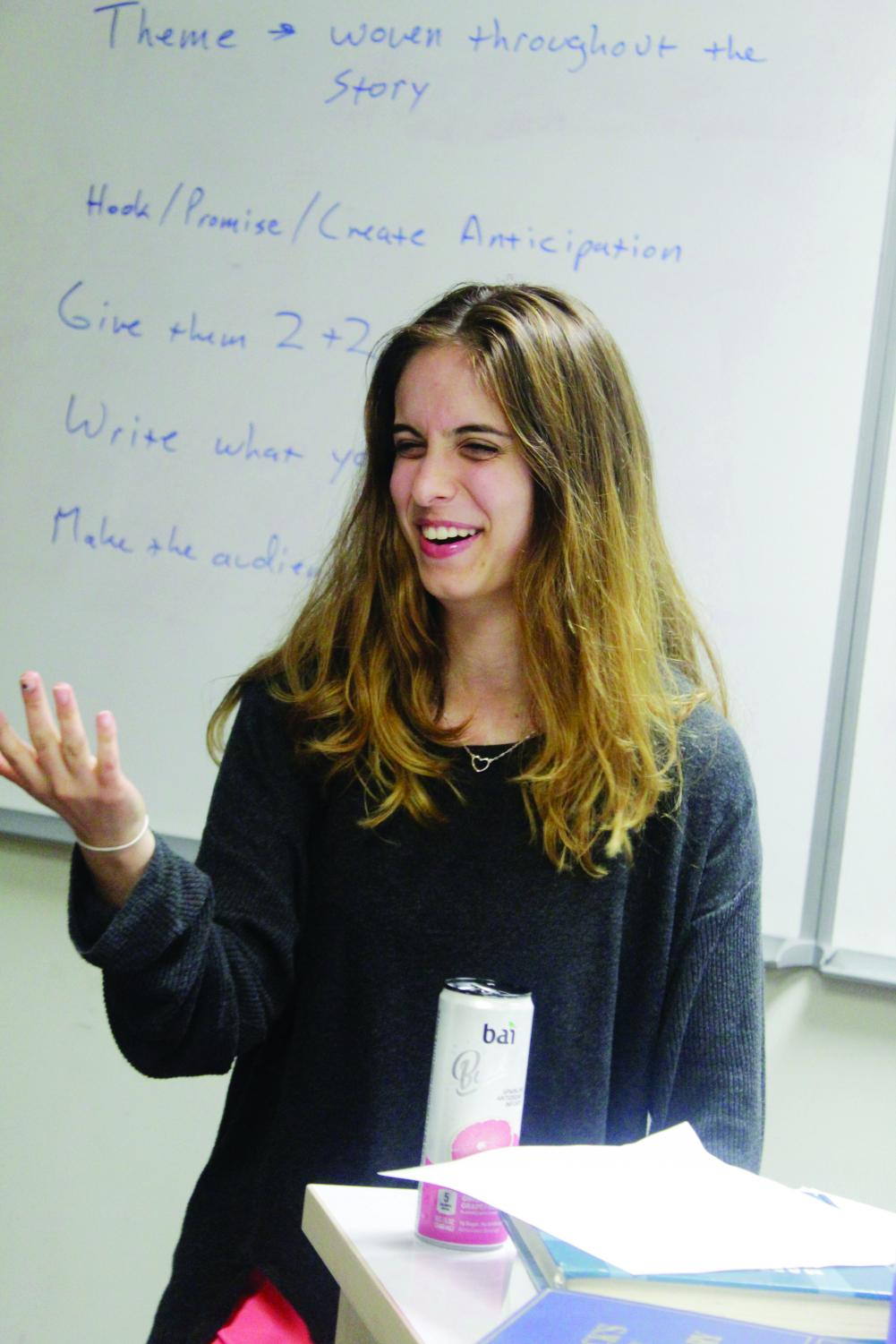 Senior Vera Petrovic has fun while working hard at a debate work night on Oct. 3. Like many students in debate, Petrovic has a personal connection to the topic of immigration. Her parents are from Serbia.