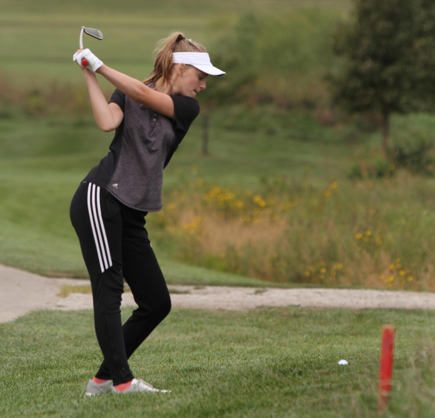 Junior Josie Abernathy hits a shot out of the rough during the Sept. 26 golf tournament at Eagle Bend. Abernathy was one of three Lions to qualify for the state tournament.